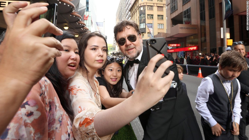 "Actor Russell Crowe poses with fans in Sydney at the premiere of the film ""The Water Diviner"" on Tuesday, December 2."