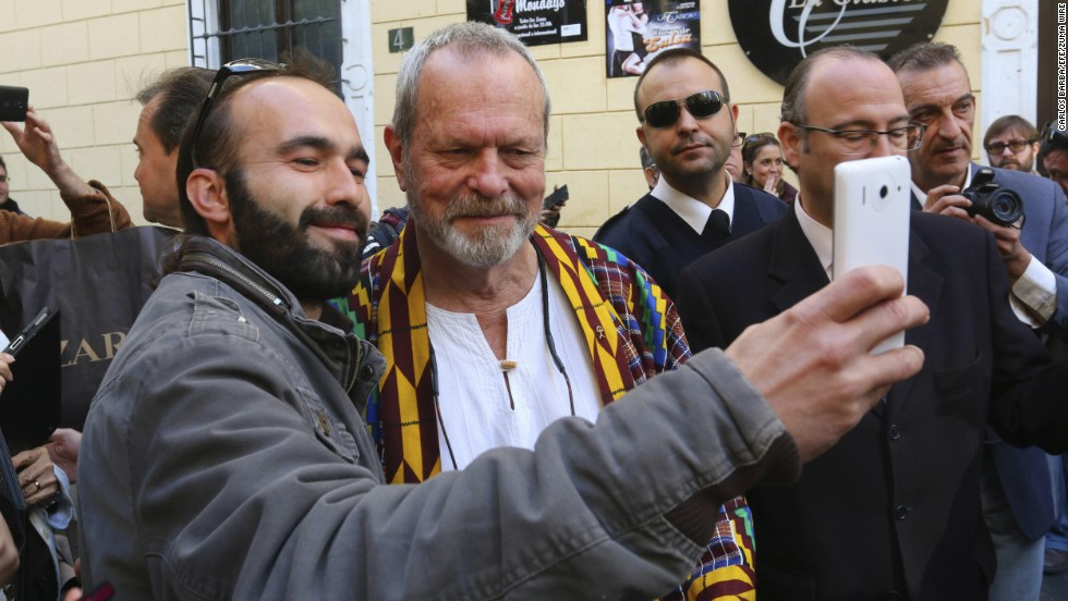 "Actor and director Terry Gilliam, a member of the ""Monty Python"" comedy group, poses with a fan after he had a star unveiled at the hall of fame in Almeria, Spain, on Wednesday, December 3."