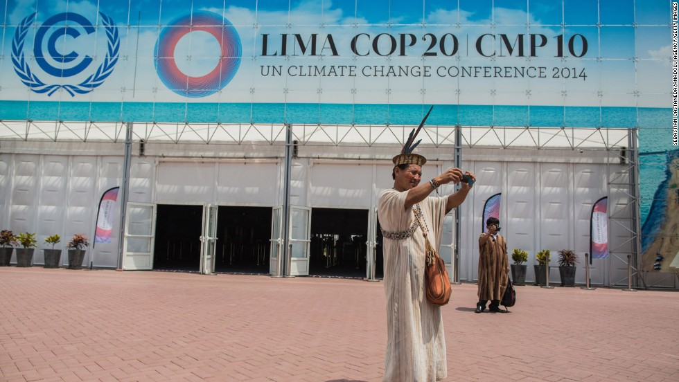 "A member of the native <a href=""http://cnnphotos.blogs.cnn.com/2013/12/03/an-indigenous-group-under-threat/"" target=""_blank"">Ashaninkas community </a>takes a selfie outside the U.N. Climate Change Conference in Lima, Peru, on Friday, December 5. <a href=""http://www.cnn.com/2014/12/03/living/gallery/look-at-me-1203/index.html"" target=""_blank"">See 26 selfies from last week</a>"