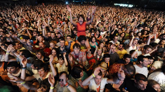 Festival goers cheer during a concert at the EXIT festival near Novi Sad on July 7, 2011. More than 150 acts are lined up for the EXIT rock and pop music festival, including Arcade Fire, Pulp, Grinderman, Portishead, M.I.A. and numerous DJs, performing at 16 different stages. The festival has been held since 2000 at an old fortress overlooking the River Danube in Novi Sad city