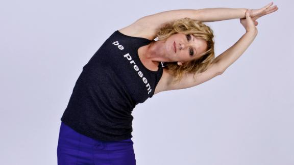 Try this standing side stretch to open yourself up and induce feelings of calm. A 2010 Harvard study found holding an open posture for two minutes lowers your stress hormones and increases testosterone which induces confidence.
