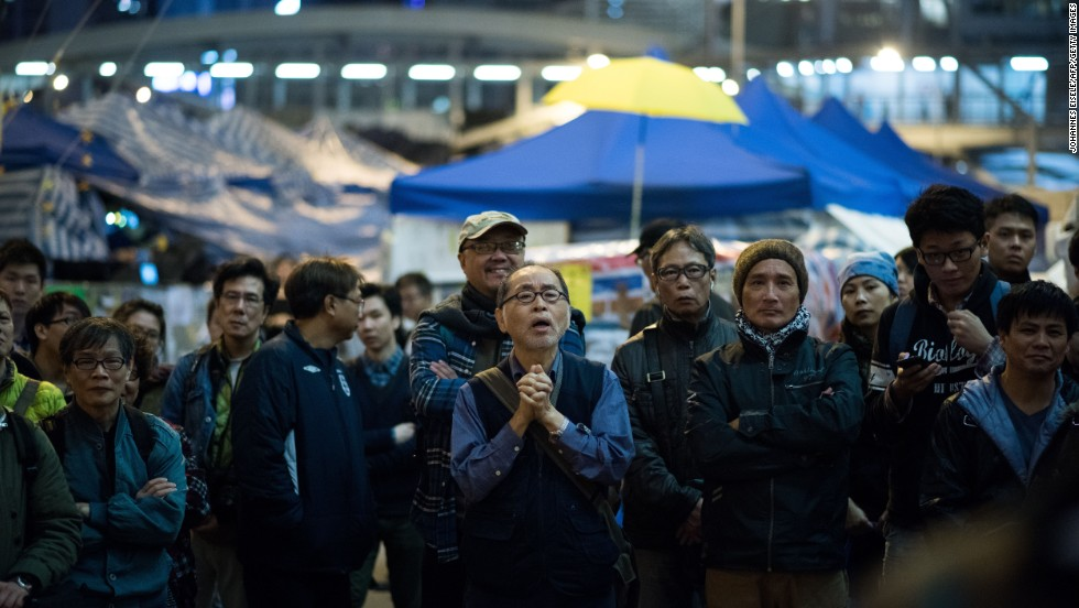 A crowd listens to a speaker at the main Hong Kong protest site in Admiralty on Tuesday, December 9.