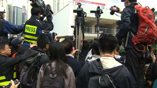 Bailiffs read injunction to HK protesters