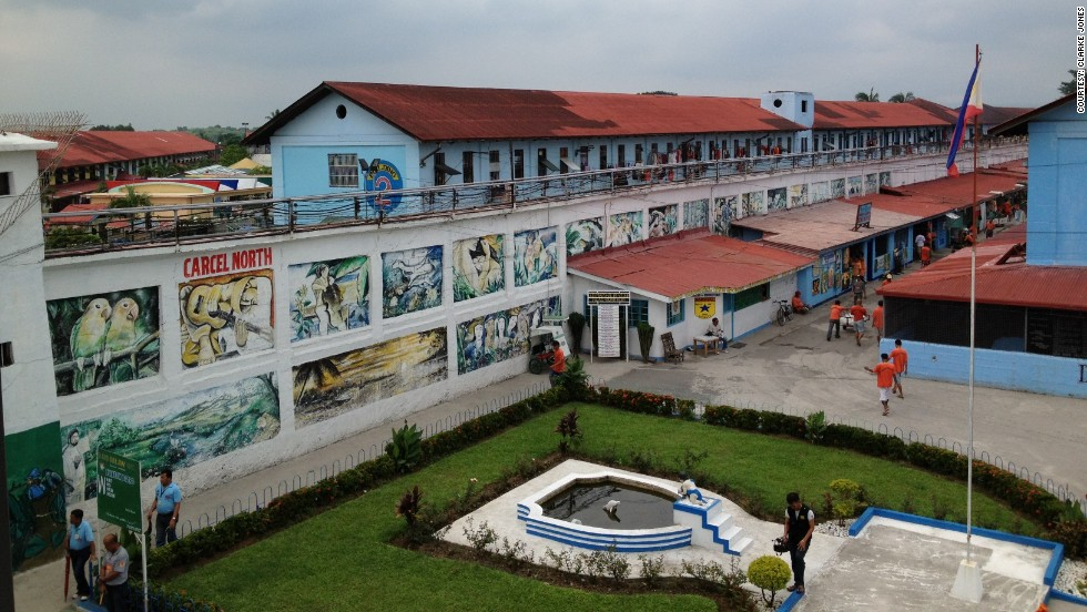 Decades ago, this wall used to separate different areas of Batang City Jail. Now inmates are free to walk between the areas, however gangs make some areas off limits. The wall is covered with paintings painted by inmates as part of their rehabilitation and to beautify the prison.