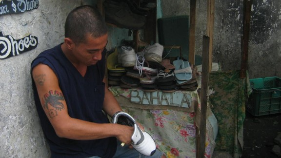 An inmate opens up his own business repairing shoes inside the prison. Narag says most inmates use their skills to earn extra money which they usually send back to help support their families.