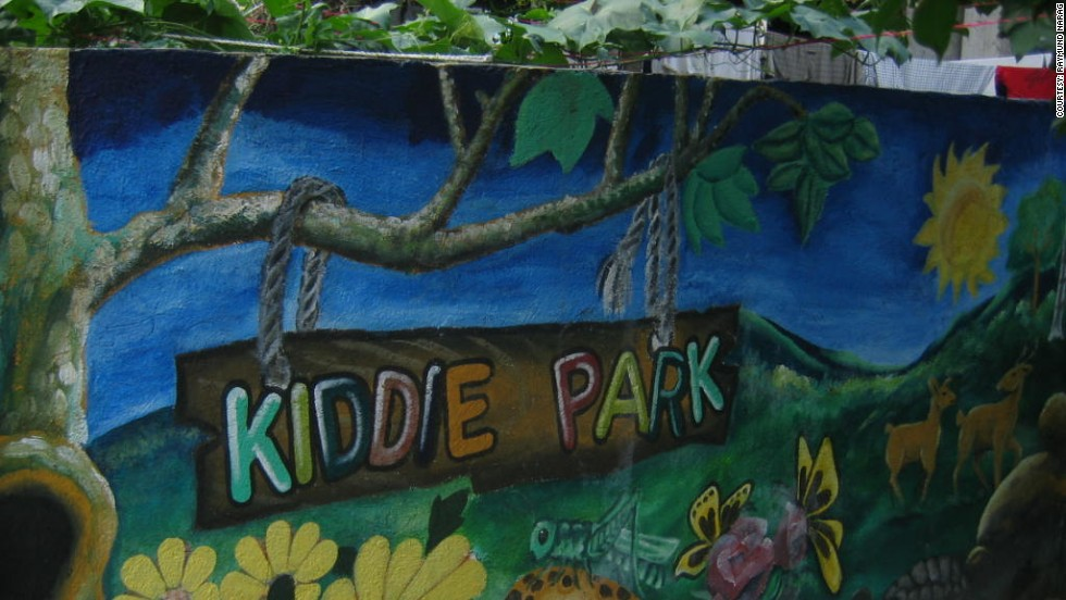 "Children of inmates also live within the walls of the prison and often play in ""Kiddie Park."" There's also a mini-zoo near the park which is popular with local families and visitors."