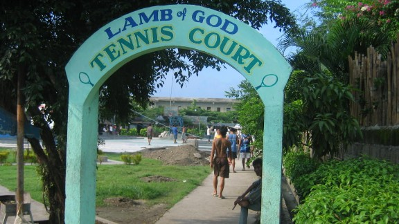 "The entrance to the mini-park and tennis court. ""This is a project of the Lamb of God Foundation, an inmate organization duly registered to the Securities and Exchange Commission,"" Narag says. ""The Tennis Court was constructed through inmate initiatives. Inmates organize competitions and invite professional tennis players to play with them."""