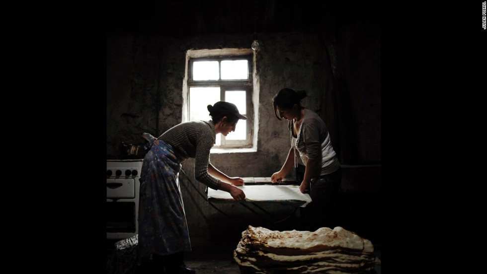 Anoush and Ruzanna, two sisters-in-law, prepare bread in the Armenian village of Lichk. Their husbands and brothers, like almost all of the village's working-age men, work in Russia for most of the year.