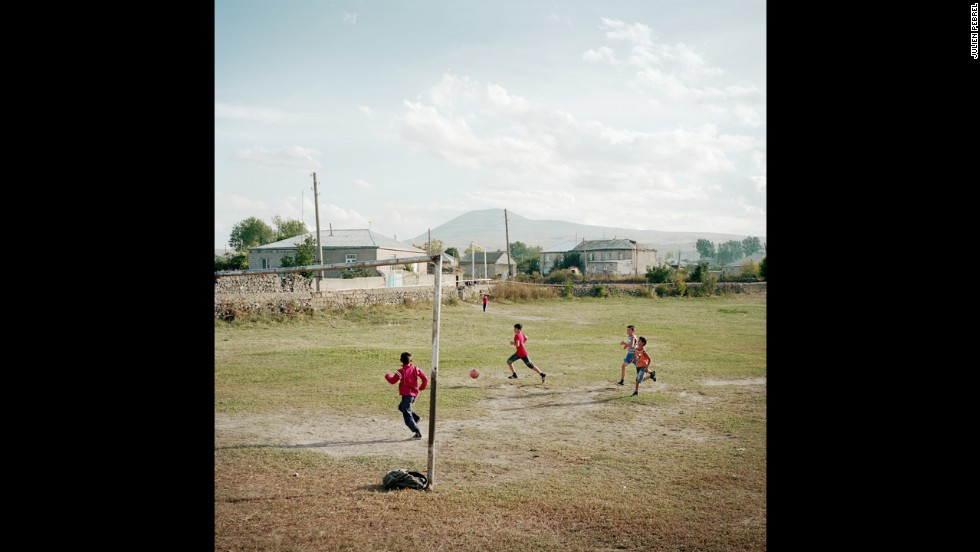 Children play on a soccer field in the village.