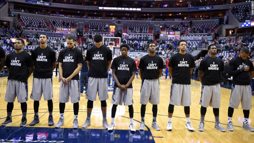 "Members of the Georgetown basketball team wear ""I can't breathe"" shirts as they stand for the national anthem before a home game Wednesday, December 10, in Washington. The shirt references the words spoken by Eric Garner, a 43-year-old man who died earlier this year after being put in a chokehold by a New York City police officer. After a grand jury decided not to bring criminal charges against the officer, demonstrators across the country <a href=""http://www.cnn.com/2014/12/04/us/gallery/eric-garner-protests/index.html"" target=""_blank"">took to the streets</a> to express their outrage."