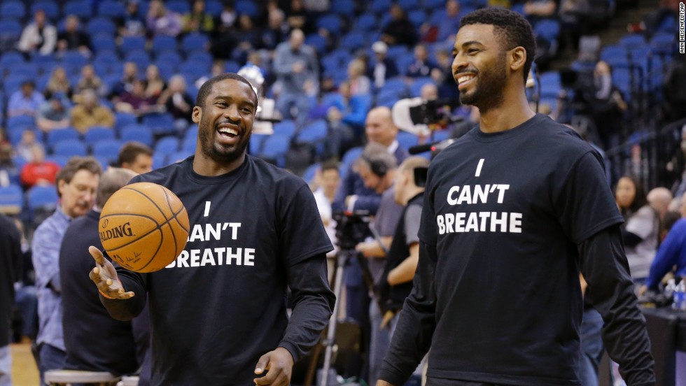 Portland Trail Blazers Wesley Matthews, left, and Dorell Wright wear the shirts while warming up for a game in Minneapolis on December 10.