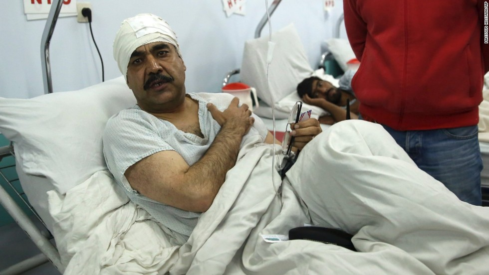 Naser Sarmast, the head of the Musicians' Institute of Afghanistan, lies on a hospital bed after the attack.