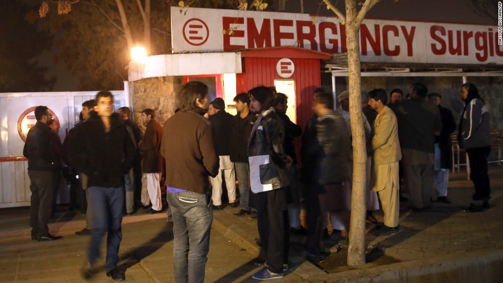 Afghans wait outside of a hospital where victims where taken.
