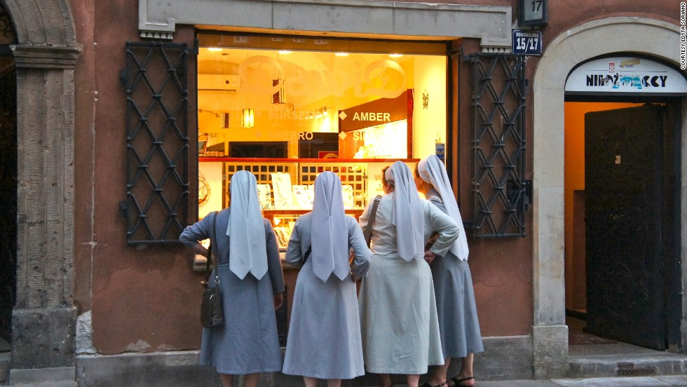 "<a href=""http://ireport.cnn.com/docs/DOC-1184017"">Edyta Soriano</a> captured a candid moment in her photo of four nuns peering into the window of a jewelry shop near Plac Zamkowy in Warsaw, Poland."