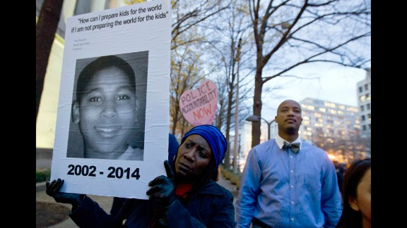 A demonstrator in Washington holds a picture of Tamir Rice on December 1 at a protest about a different case: last month's decision by a grand jury not to indict a police officer in the shooting death of Michael Brown in Ferguson, Missouri.
