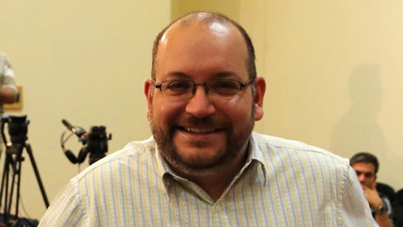 A file picture shows Iranian-American Washington Post correspondent Jason Rezaian posing while covering a press conference at Iran's Foreign Ministry in Tehran, on September 10, 2013. Tehran's chief justice Gholamhossein Esmaili confirmed the arrest of Washington Post correspondent Jason Rezaian and his wife, also a journalist, the official IRNA news agency reported. Rezaian, 38, has been the Post correspondent in Tehran since 2012 and holds both American and Iranian citizenship, according to the newspaper and his wife is an Iranian who has applied for US permanent residency and works as a correspondent for The Nation newspaper based in the United Arab Emirates, the Post said. AFP PHOTO/STRSTR/AFP/Getty Images