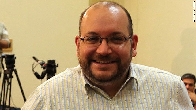 A file picture shows Iranian-American Washington Post correspondent Jason Rezaian and his Iranian wife Yeganeh Salehi posing while covering a press conference at Iran's Foreign Ministry in Tehran, on September 10, 2013. Tehran's chief justice Gholamhossein Esmaili confirmed the arrest of Washington Post correspondent Jason Rezaian and his wife, also a journalist, the official IRNA news agency reported. Rezaian, 38, has been the Post correspondent in Tehran since 2012 and holds both American and Iranian citizenship, according to the newspaper and his wife is an Iranian who has applied for US permanent residency and works as a correspondent for The Nation newspaper based in the United Arab Emirates, the Post said. AFP PHOTO/STRSTR/AFP/Getty Images