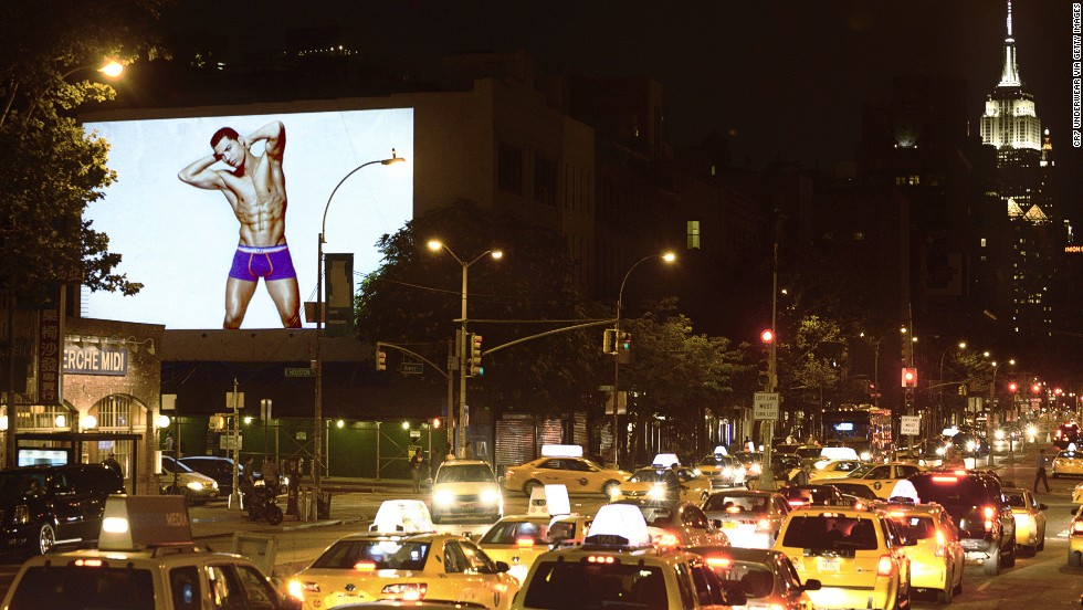 Cristiano Ronaldo shows off his briefs in the Bowery district of New York. Huge images of the Real Madrid star where projected in major cities for the launch of his CR7 underwear range in 2013.