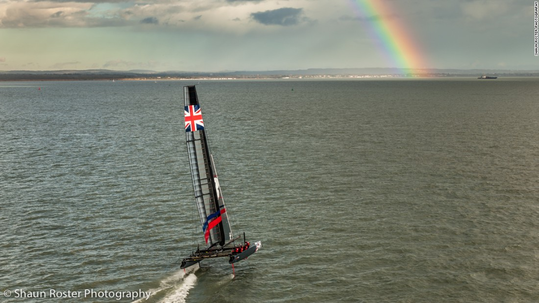 A rainbow in the distance greets the Ben Ainslie Racing team in mixed conditions in Portsmouth