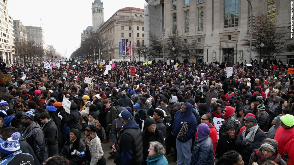 Protesters fill the street as they gather for a march on December 13 in Washington.