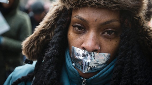 """A demonstrator marches in New York on December 13 during the """"Justice for All"""" rally."""