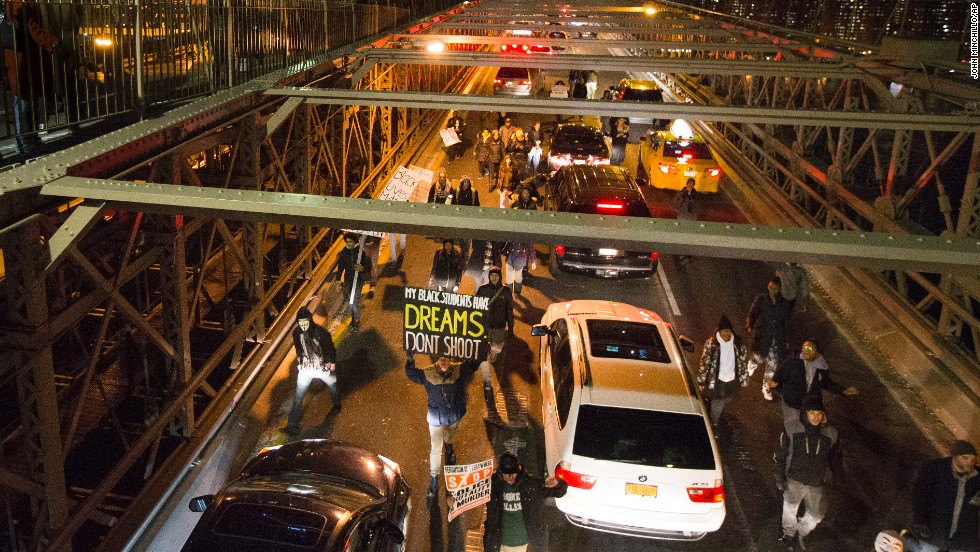 Demonstrators march over the inbound lane of the Brooklyn Bridge in New York on December 13.