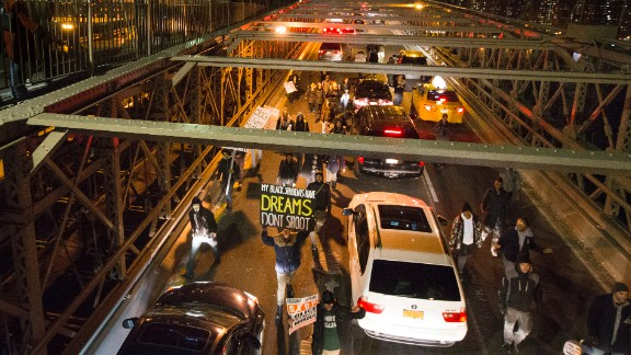 Demonstrators march over the inbound lane of the Brooklyn Bridge in New York on December 13.