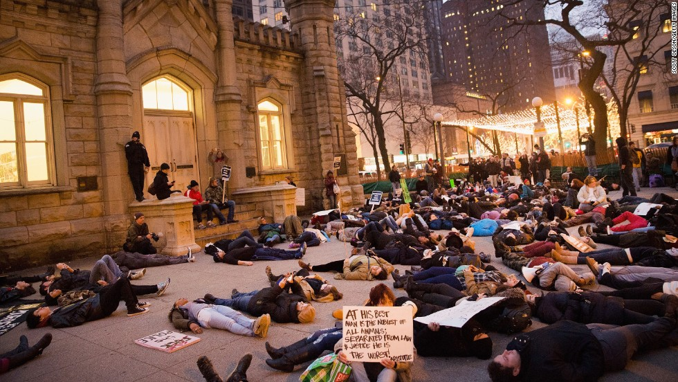 "Protesters stage a ""die-in"" during a march in Chicago on December 13."