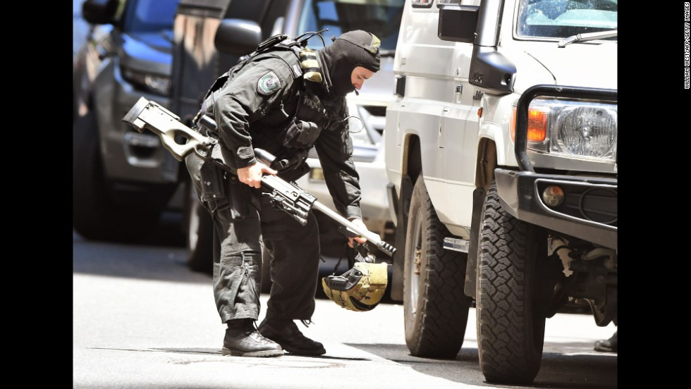 A police sniper walks to his vehicle on December 15.
