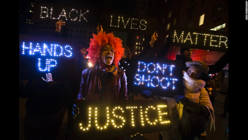 Demonstrators chant during a rally in downtown Manhattan on December 13.
