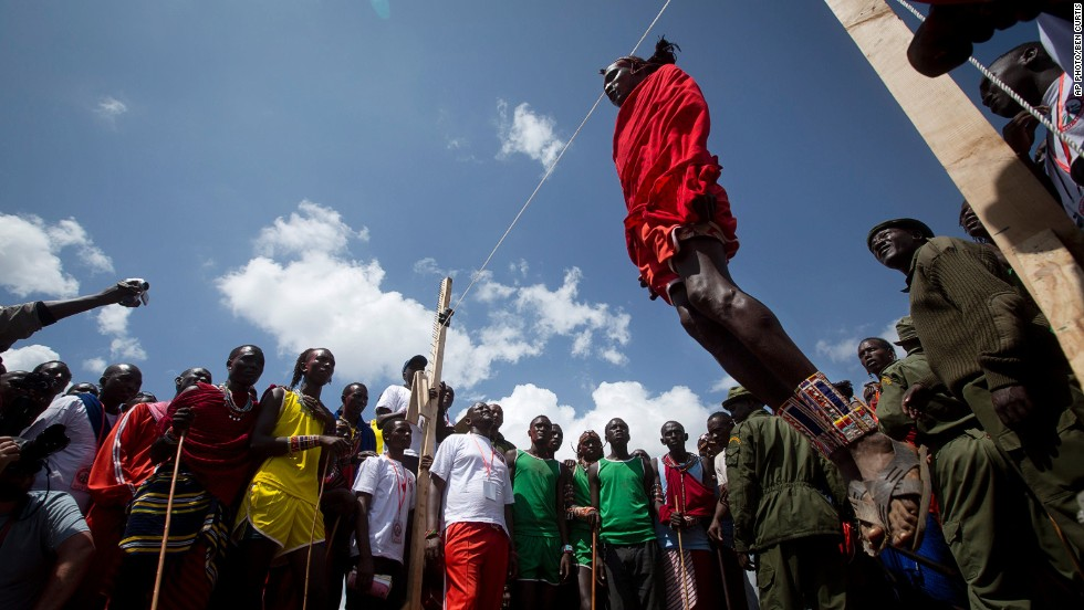 "DECEMBER 15 - SIDAI OLENG WILDLIFE SANCTUARY, KENYA: A Maasai warrior competes in the high jump, in which athletes must touch a fixed line with the top of their heads, at the annual <a href=""http://cnn.com/2014/12/05/africa/gallery/maasai-olympics/"">Maasai Olympics</a> near Mount Kilimanjaro. Maasai men and women from the Amboseli and Tsavo region compete for medals and prizes in the event which aims to replace lion hunting as the traditional warrior activity."
