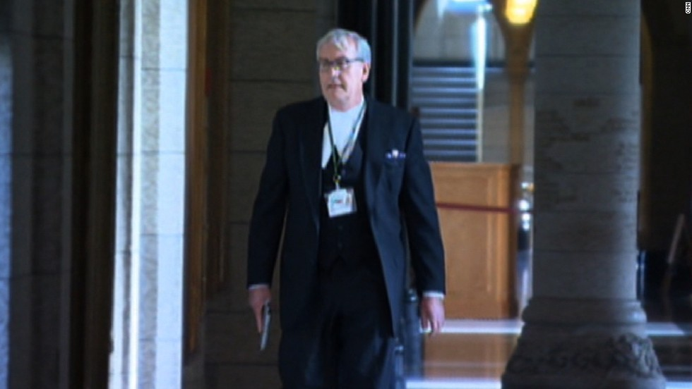 Kevin Vickers, sergeant-at-arms for Canada's House of Commons, is seen here with his gun drawn moments after gunning down an armed man who killed an army reservist and then stormed an Ottawa Parliament building in October. Vickers was hailed as a hero for his bravery, which may have saved many lives.