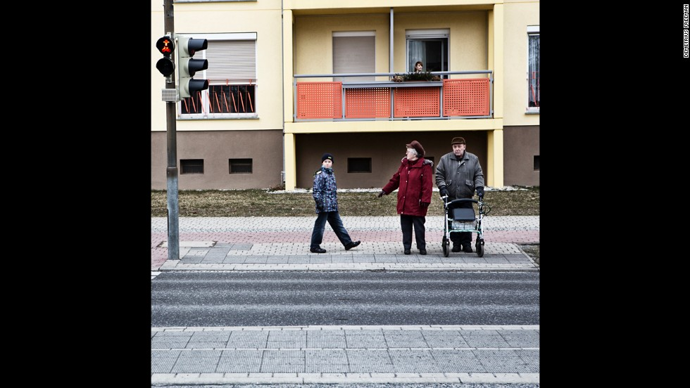 A couple and their grandson wait to cross the street. Hoyerswerda's average age is 48, Freeman said, and it continues to climb while the 20-30 age group has dropped dramatically.