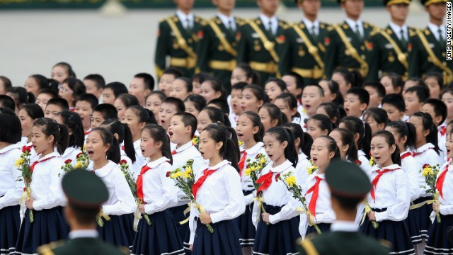 Chinese children sing the national anthem near the Monument to the People's Heroes in Beijing on Sept. 30.