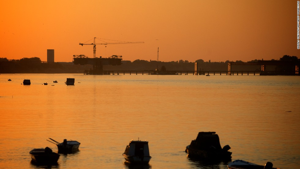 Today Belgrade is stepping up its efforts to rebuild once again. Pictured here, construction work of a new bridge over the Danube on July 23, 2013.