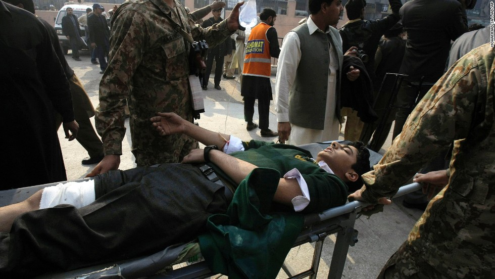A student is wheeled into a hospital in Peshawar.