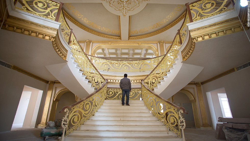 "DECEMBER 16 - IRBIL, IRAQ: A construction worker walks up the staircase inside a $20 million replica of the White House being built inside Dream City. The exclusive residential suburb is one of several<a href=""http://cnn.com/2014/01/07/business/can-black-gold-fuel-luxury-iraqi/""> high value areas developed in the Kurdish capital </a>since 2003, complete with their own mosque, shopping areas and schools."