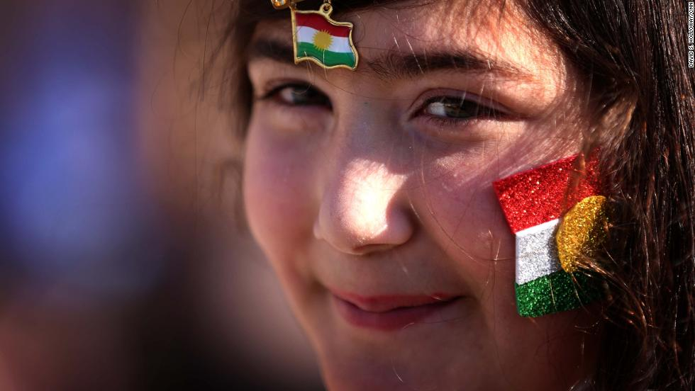 DECEMBER 17 - IRBIL, IRAQ: A young woman with the Kurdish flag decorating her face smiles as she takes part in celebrations for Flag Day in the capital of the autonomous Kurdish region.