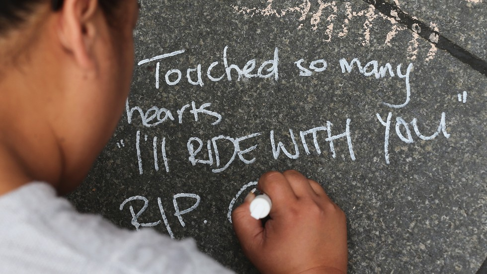 A message of condolence is written on the pavement at Martin Place, Sydney on Wednesday, December 17. #illridewithyou became a trending hashtag on Twitter during the siege, expressing solidarity with Australian Muslims in the wake of deadly siege at the Lindt Cafe in Sydney.
