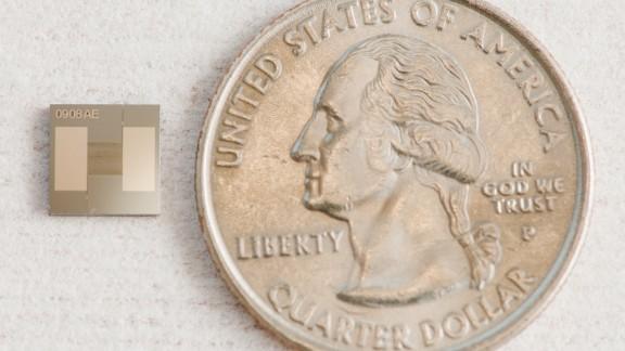 The tiny chip next to a U.S. quarter.