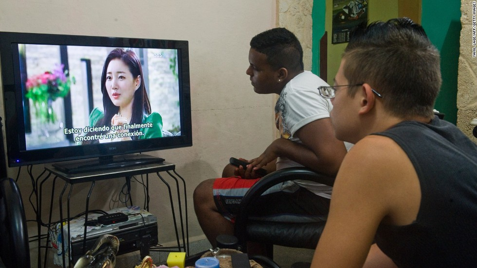 Cubans watch a South Korean soap opera DVD in Havana, on December 5, 2013. South Korea's National Intelligence Service told lawmakers in October that officials from the North's ruling party had been executed by firing squad for viewing a South Korean soap opera.