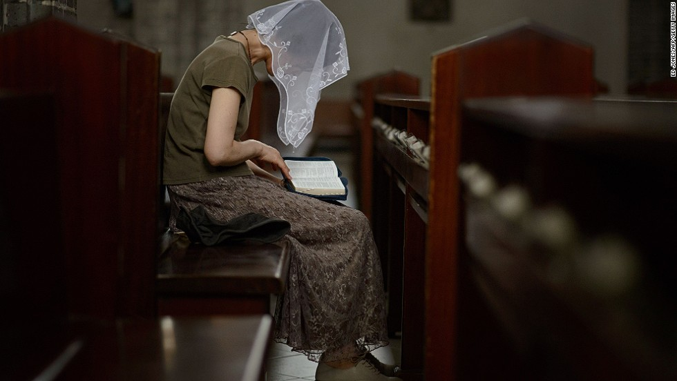 A Catholic worshiper reads from a Bible at the Myeong-dong Cathedral in Seoul on August 6, 2014. Although North Korea has some state-controlled churches, the regime forbids independent religious activities.