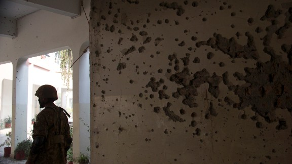 Bullet holes litter the walls of the school.