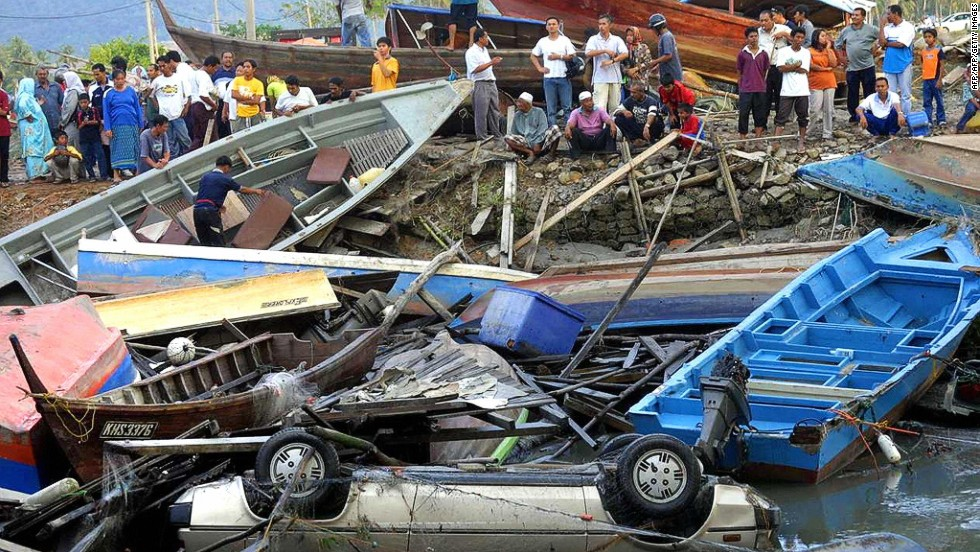 Fishing boats and a car are among the debris left along the coast of Langkawi in northwest Malaysia on December 26, 2004.