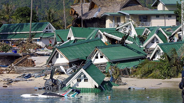 Dozens of gift shops which once stand by the beach next to the ferry jetty destroyed by the tidal waves on the Phi Phi island in southern Thailand holiday resort 27 December 2004. An earthquake measuring 9.0 on the Richter scale struck off the coast of Sumatra, Indonesia, 26 December, and ensuing tsunami and aftershocks have claimed 17,200 lives in the south and southeast regions of Asia. AFP PHOTO/ROSLAN RAHMAN (Photo credit should read ROSLAN RAHMAN/AFP/Getty Images)