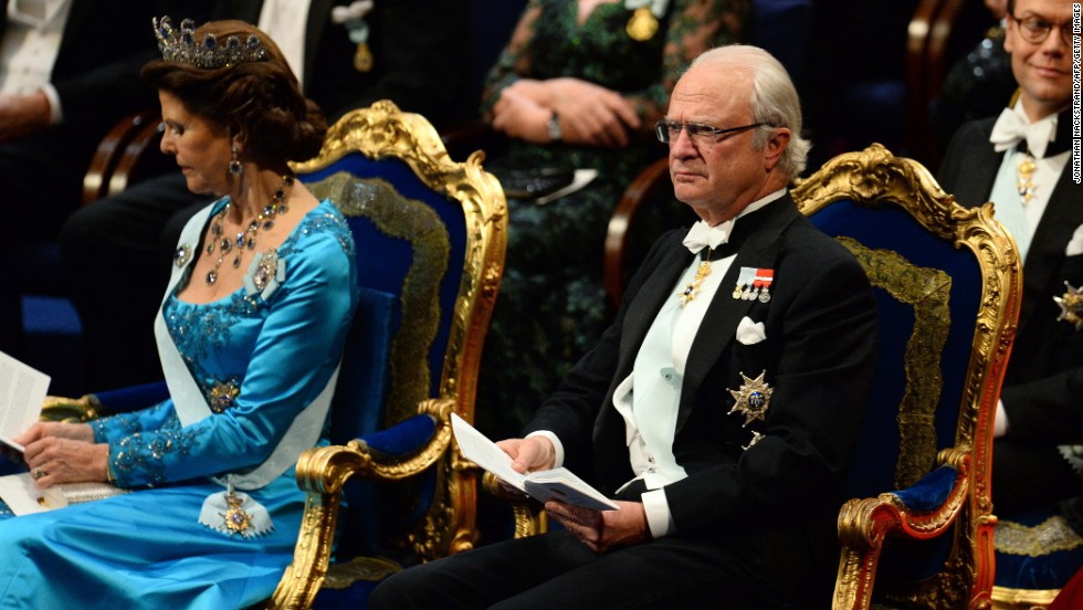 King of Sweden Carl XVI Gustaf and Queen Silvia attend the 2014 Nobel prize award ceremony at the Stockholm Concert Hall on December 10, 2014.