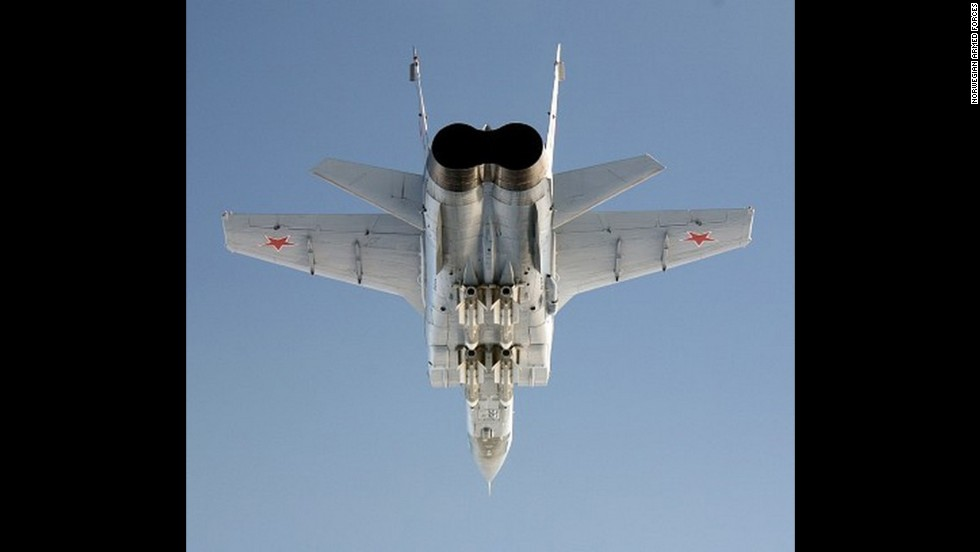An armed MiG-31 Foxhound photographed from below by a Norwegian Royal Air Force interceptor.