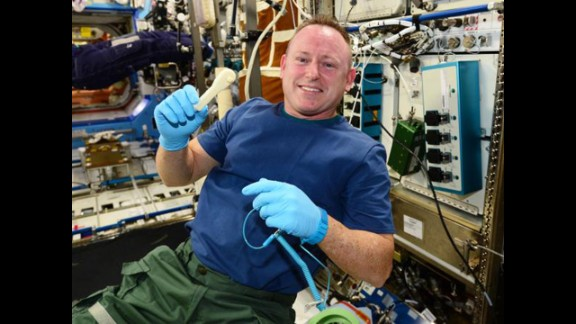 "Astronaut Barry ""Butch"" Wilmore holds up the ratchet after removing it from the print tray."