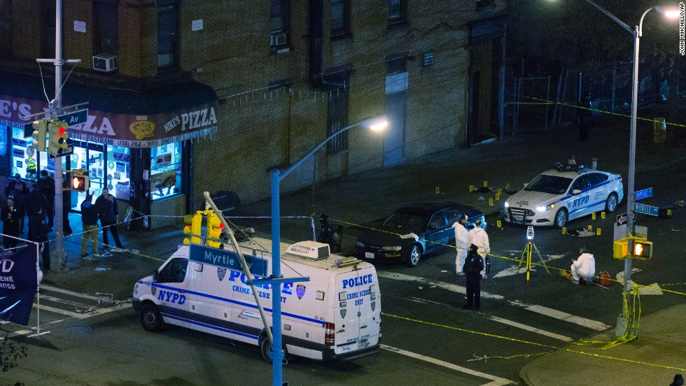 The officers were shot and killed ambush-style Saturday afternoon as they sat in their patrol car in Brooklyn, officials said.
