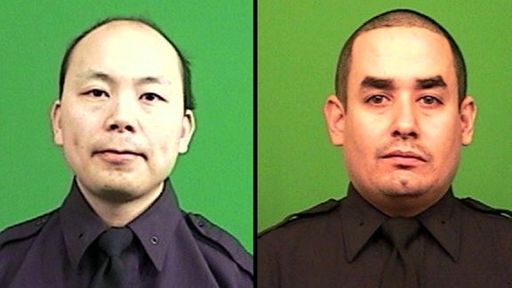 New York police officers Wenjian Liu, left, and Rafael Ramos.